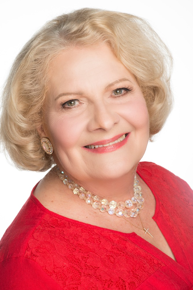 Headshot of Carol Stanley wearing a red top