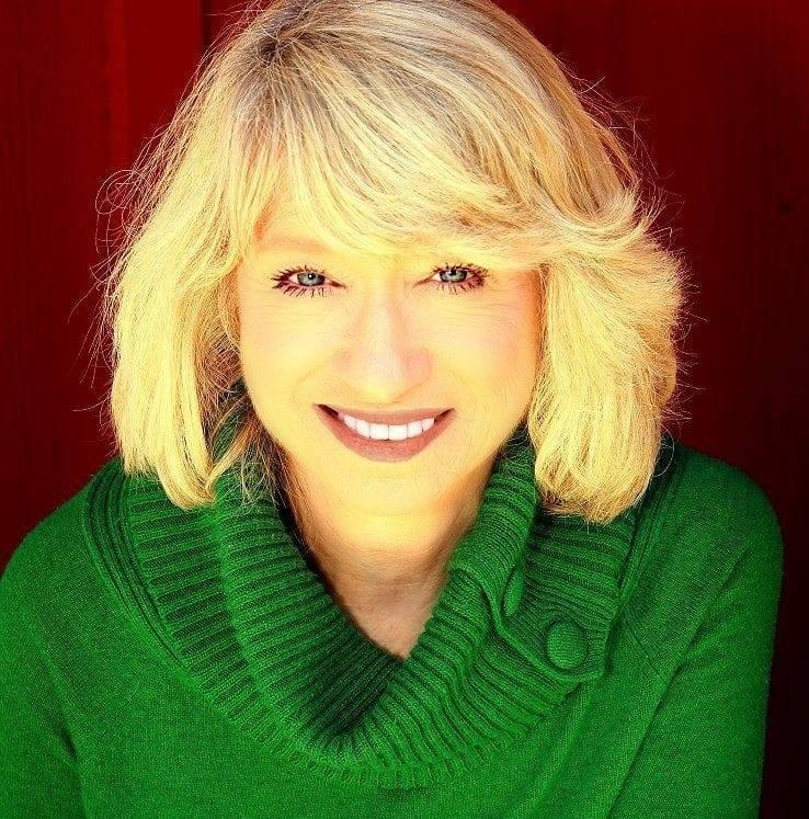 Headshot of Mary Maas wearing a green sweater