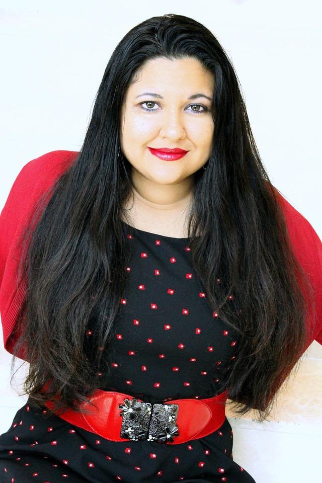 Sophia Olivas in black and red dress