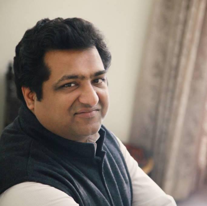 Headshot of Tushar Kansal